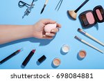 makeup products and female hand ... | Shutterstock . vector #698084881