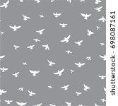 white flying birds on a gray... | Shutterstock .eps vector #698087161