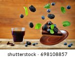 flying chocolate tart with... | Shutterstock . vector #698108857