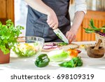 chef cutting fresh and... | Shutterstock . vector #698109319