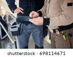 manual workers using digital... | Shutterstock . vector #698114671