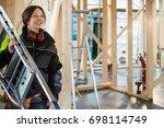female carpenter carrying... | Shutterstock . vector #698114749