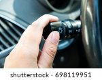lights control of a car. woman... | Shutterstock . vector #698119951