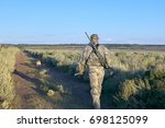 Rear View Of Hunter Walking...