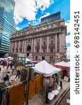 Small photo of New York, USA - April 24, 2015: Street view of Alexander Hamilton US Custom House, Lower Manhattan, New York, NYC, USA. Now it is the National Museum of American Indians. Tourist nearby