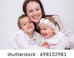 mother with her two cute... | Shutterstock . vector #698152981