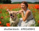 Happy Woman With Dog Labrador...