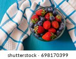 berry fresh in a copper cup on... | Shutterstock . vector #698170399