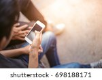 man holding and using cell... | Shutterstock . vector #698188171