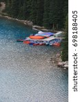 Small photo of Moraine Lake. Lake Louise. Banff. Alberta. Canada. Aug 10 2017. Boats anchored to shore after all the visitors left the area. Summer in Moraine is getting very busy. Parking spot is hard to come by.