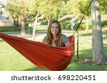 sitting in a hammock on summer... | Shutterstock . vector #698220451