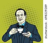 man drinking a cup of tea.... | Shutterstock .eps vector #698229289
