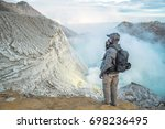 male photographer with backpack ... | Shutterstock . vector #698236495