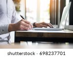 creative hand taking notes on... | Shutterstock . vector #698237701