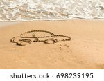 draw car on beach sand.... | Shutterstock . vector #698239195