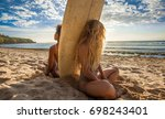 Surfer Girls Sitting Back To...