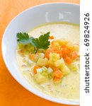 Vegetable soup with carrot, cabbage and potatoes in bowl - stock photo