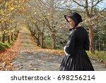 victorian woman on autumn road... | Shutterstock . vector #698256214