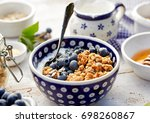 granola with natural yogurt ... | Shutterstock . vector #698260867