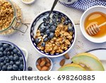 granola with natural yogurt ... | Shutterstock . vector #698260885