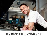 handsome mechanic based on car... | Shutterstock . vector #69826744