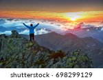 happy woman on the top of the... | Shutterstock . vector #698299129