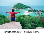 a man standing on top mountain...   Shutterstock . vector #698314591