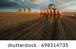 farmer with tractor seeding  ...   Shutterstock . vector #698314735