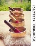 tibetan singing bowls. sound of ... | Shutterstock . vector #698317924