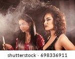 closeup shot of two young women ... | Shutterstock . vector #698336911