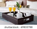 Stock photo breakfast tray on a bed 69833788