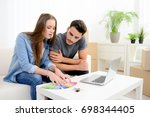 happy young couple student... | Shutterstock . vector #698344405