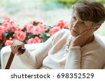sad elder lady sitting on the... | Shutterstock . vector #698352529