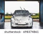 car in outdoors self service... | Shutterstock . vector #698374861
