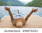 girl enjoying at the jetty... | Shutterstock . vector #698376331