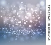 bokeh lights and snow particles ... | Shutterstock .eps vector #698384161