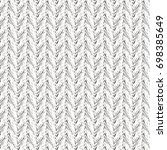 white knit fabric. herringbone... | Shutterstock .eps vector #698385649