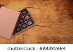 chocolate box on table | Shutterstock . vector #698392684