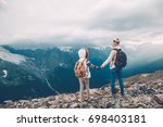 hikers with backpack looking at ... | Shutterstock . vector #698403181