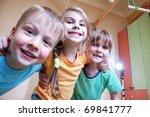 three happy kid in a domestic... | Shutterstock . vector #69841777