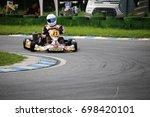 go kart driver on the circuit... | Shutterstock . vector #698420101