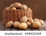 A Lot Of Potatoes In A Wicker...