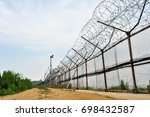 military barbed wire... | Shutterstock . vector #698432587