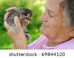 Stock photo senior woman holding little kitten 69844120