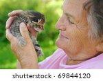 Stock photo senior woman holding little kitten 69844120