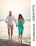 young spouses go along the... | Shutterstock . vector #698447974
