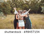 Several Girls Stand In A Circl...