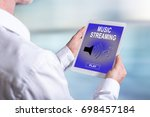 tablet screen displaying a... | Shutterstock . vector #698457184