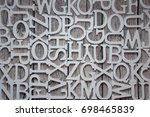 a set of letters on wooden... | Shutterstock . vector #698465839