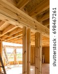Building a house in skeleton technology, stage before installing thermal insulation - stock photo
